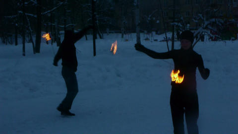 Fire show - tricks with burning poi Live Action