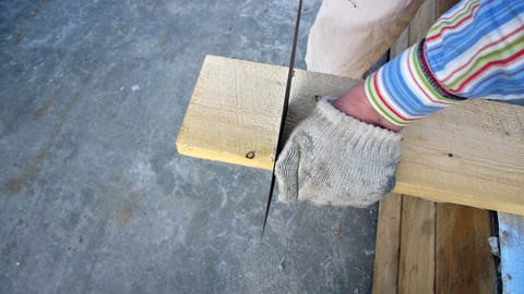 Sawing the plank with a hand saw Stock Video Footage