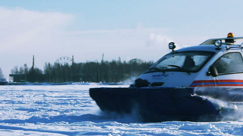 Hovercraft on the frozen lake against a blue sky Stock Video Footage