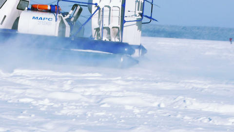 Hovercraft On The Frozen Lake Against A Blue Sky stock footage