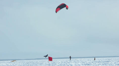 Snowkiting jumping slow motion 100 fps video Footage