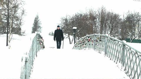 Man crossing the bridge Stock Video Footage