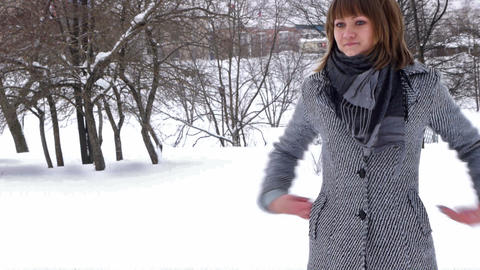 Young female model posing in winter park Stock Video Footage