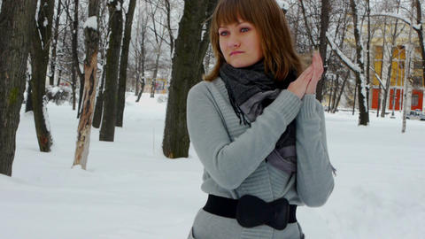 Young female model posing in winter park Footage