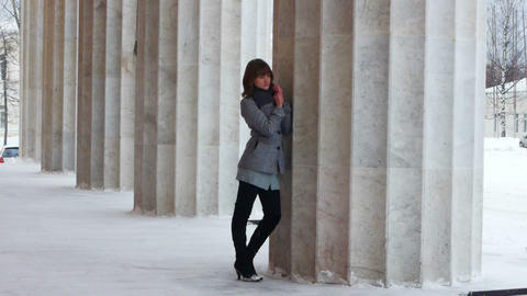 Young Female Model Posing Near Column stock footage