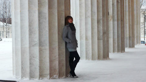 Young female model posing near column Footage