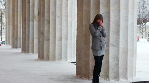 Young female model posing near column Stock Video Footage