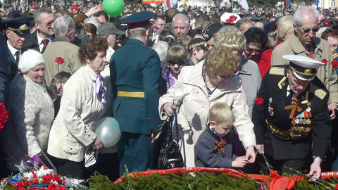 PETROZAVODSK, RUSSIA -MAY 09: Crowd of people lay Stock Video Footage