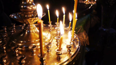 Burning flame of candles in church Stock Video Footage