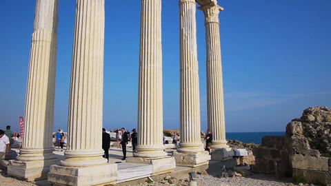 Tourists sighseeing the Temple of Apollo ruins in Stock Video Footage
