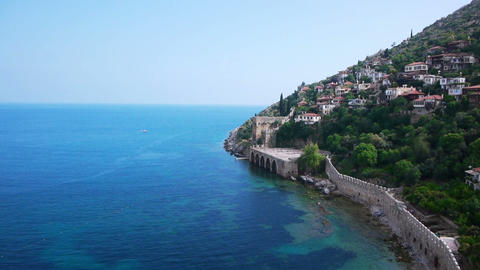 Light-colored houses on Mediterranean sea shore in Stock Video Footage