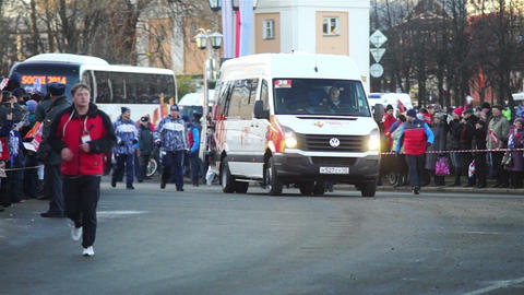 Sochi2014 Olympic torch relay procession on street Stock Video Footage