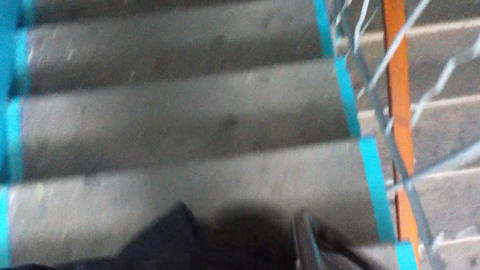 Man walking down the stairs point of view video Stock Video Footage