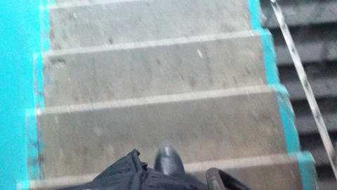 Man walking down the stairs point of view video Footage