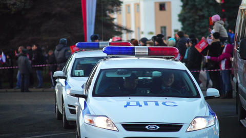 Patrol police cars on Sochi2014 Olympic torch rela Stock Video Footage