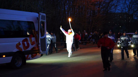 Vladimir Zinkov running with flaming torch at Soch Stock Video Footage