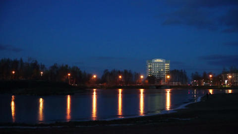Evening lights of Petrozavodsk on river shore Stock Video Footage
