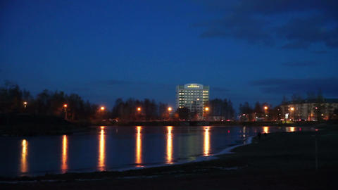 Evening lights of Petrozavodsk on river shore Footage