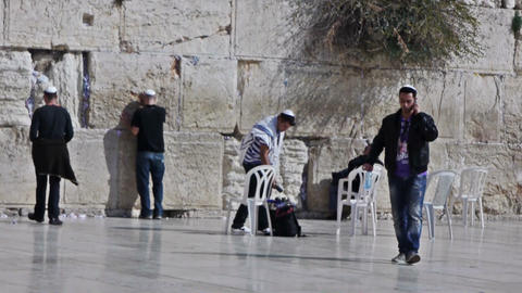 Many people with white kippah near Western Wall, J Stock Video Footage
