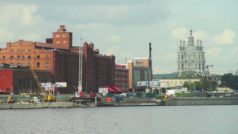 Urban view of old factory building and church on N Footage