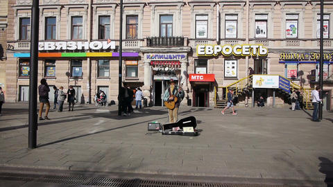 Street musician with guitar entertaining public Stock Video Footage