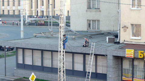 PETROZAVODSK, RUSSIA -July, 08: Men repairing elec Stock Video Footage