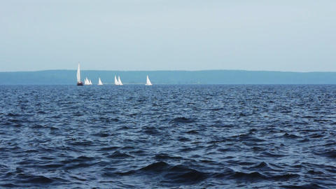 Sailboat in regatta on blue sea Footage
