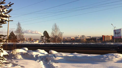Winter landscape with traffic and smoking pipes ti Footage