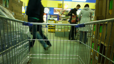 Shoping cart in supermarket time lapse Footage