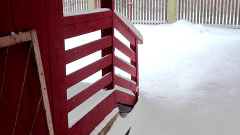 Yard near wooden cottage at snowfall Footage