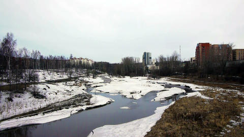 Spring landscape with snowy river Footage