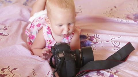 child in dress lay on the bed Footage