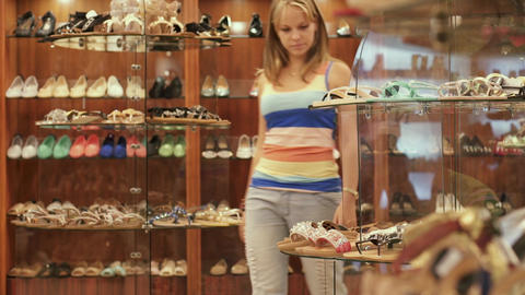 Young Woman Shopping In Mall Buying Fashion Shoes stock footage