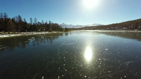 4K Aerial Footage Mountain Lake Ice Covered In Win stock footage