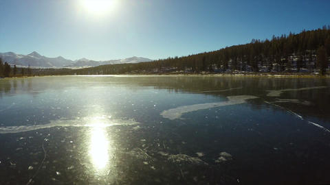 Aerial Stock Footage Mountain Lake Ice Covered wit Footage