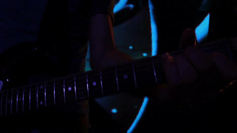 Shooting of the clip for rock band: solo on electric guitar (close-up) Footage