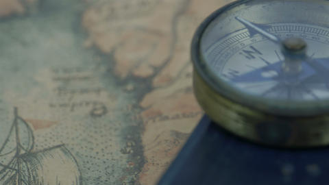 The compass and the bible on the map Footage