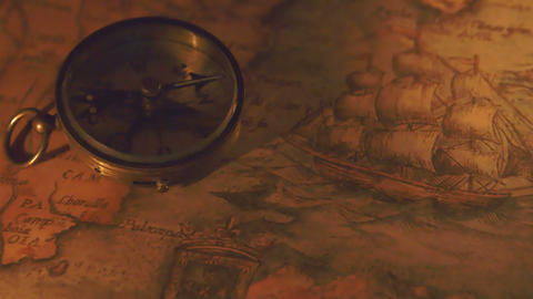 The shadow of the compass showing on the map Footage