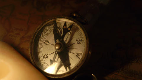Zoom in view of the compass and the candle Footage