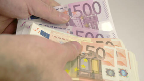 A mans hand is counting his Euro moneys Footage