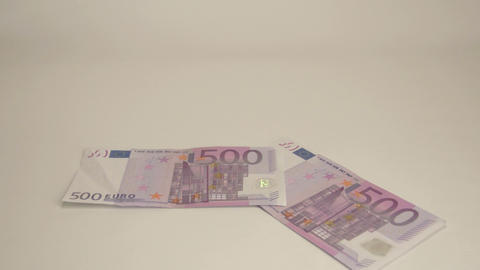 Four 500 Euro bill drops on the table Footage