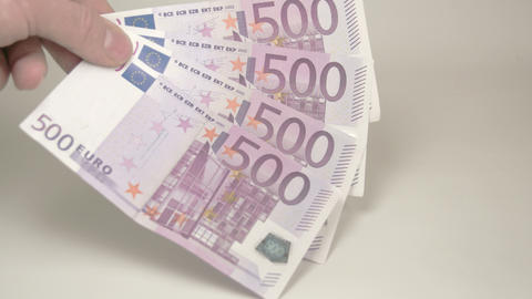 Four 500 Euro bills on the hand Live Action