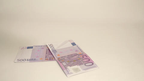Four 500 Euro bills are thrown on the table Live Action