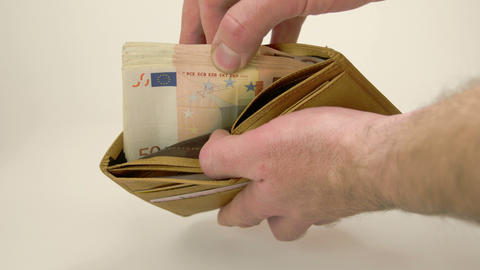A man counting off his money in his wallet Footage