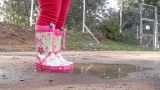 Children Jump Rain Puddle Boots Girl Playground stock footage