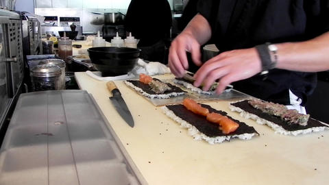 Japanese gourmet asian seafood Restaurant food Chef preparing sushi salmon fish rice Live Action