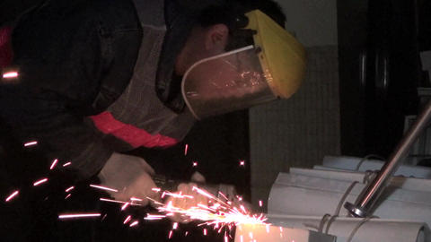 Working Man In A Workshop Using An Electric Grinde stock footage