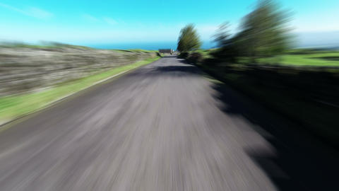 Fast Driving onto Curved Mountain Road Live Action