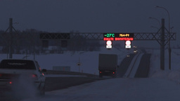 Traffic on the dark highway in winter Footage