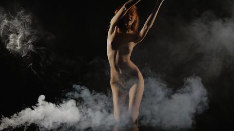 Young Girl Posing Nude, Naked In Smoke, Slow-motio stock footage